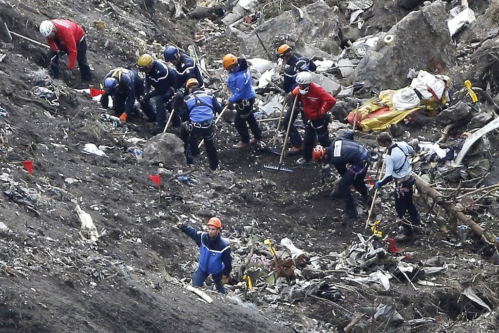 Rescue workers work on debris of the Germanwings jet at the crash site near Seyne-les-Alpes, France, Thursday. (AP Photo/Laurent Cipriani)