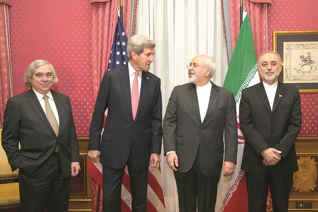 L-R: U.S. Energy Secretary Ernest Moniz, U.S. Secretary of State John Kerry, Iran's Foreign Minister Mohammad Javad Zarif and the head of the Atomic Energy Organization of Iran Ali Akbar Salehi pose for a photograph before resuming talks over Iran's nuclear program, in Lausanne, Switzerland, Monday. (AP Photo/Brian Snyder, Pool)