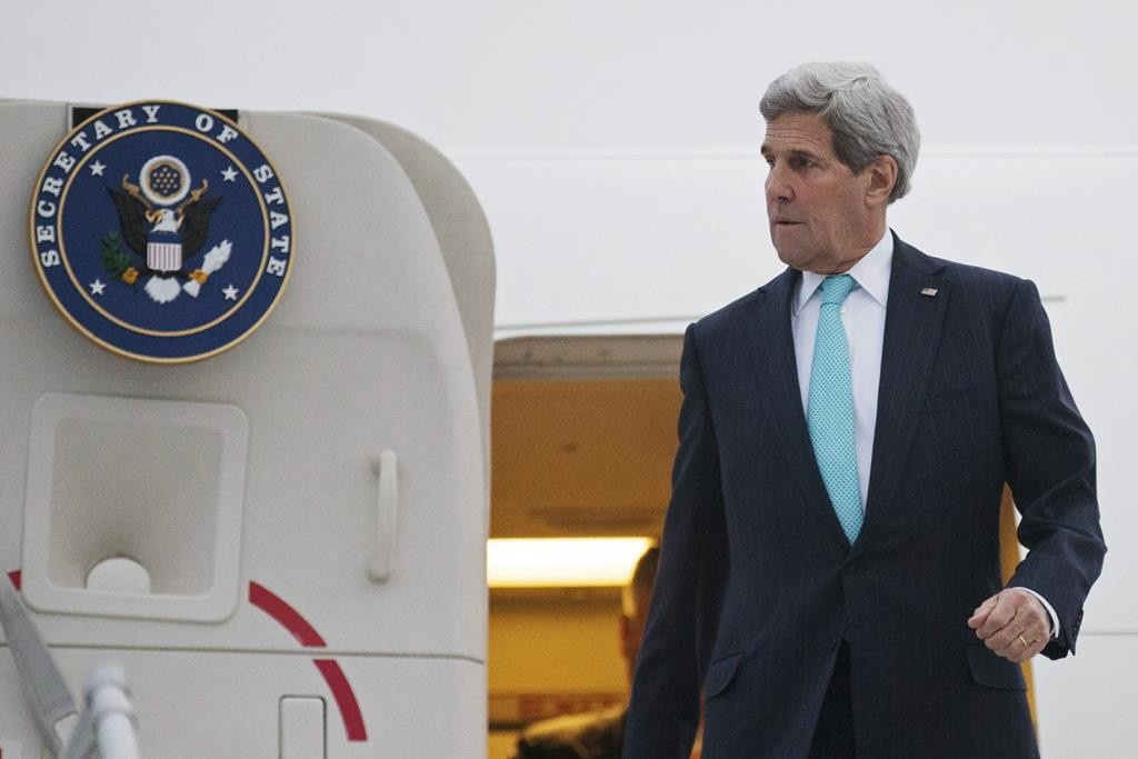 U.S. Secretary of State JohnKerrydisembarks from his plane as he arrives in Geneva, Switzerland, Sunday.Kerryis in Geneva to resume talks with Iranian officials. (AP Photo/Brian Snyder, pool)