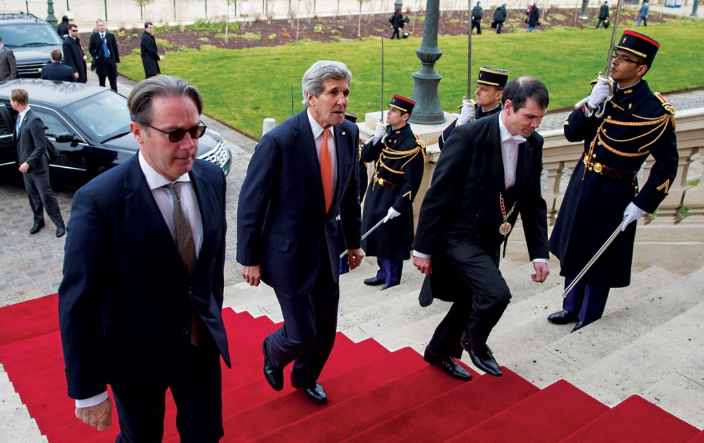 U.S. Secretary of State John Kerry (2nd L) arrives to meet France's Foreign Minister Laurent Fabius in Paris this past weekend where they discussed the negotiations with Iran. (REUTERS/Evan Vucci/Pool)