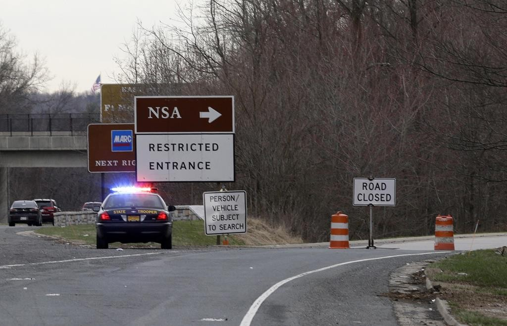 A Maryland State Police cruiser sits at a blocked southbound entrance on the Baltimore-Washington Parkway that accesses the National Security Agency, in Fort Meade, Maryland, Monday. (AP Photo/Patrick Semansky)
