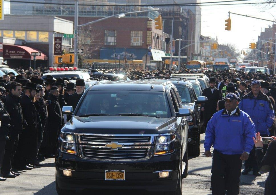 "Some of the seven hearses carrying the seven Sassoon children, z""l, who were killed in a tragic fire on Friday night in Midwood, leave the chapel following the levayah. (Shimon Gifter)"