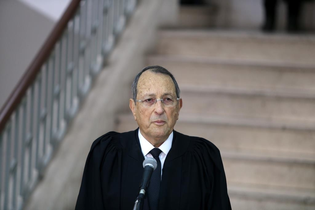 Prosecuter Ori Korev speaks with the press after former Prime Minister Ehud Olmert was convicted on corruption charges Monday. (Amit Shabi/POOL)