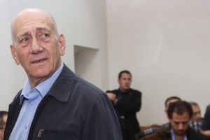 Former Prime Minister Ehud Olmert seen at the district court where he was convicted on corruption charges Monday. (Gili Yohanan/POOL)