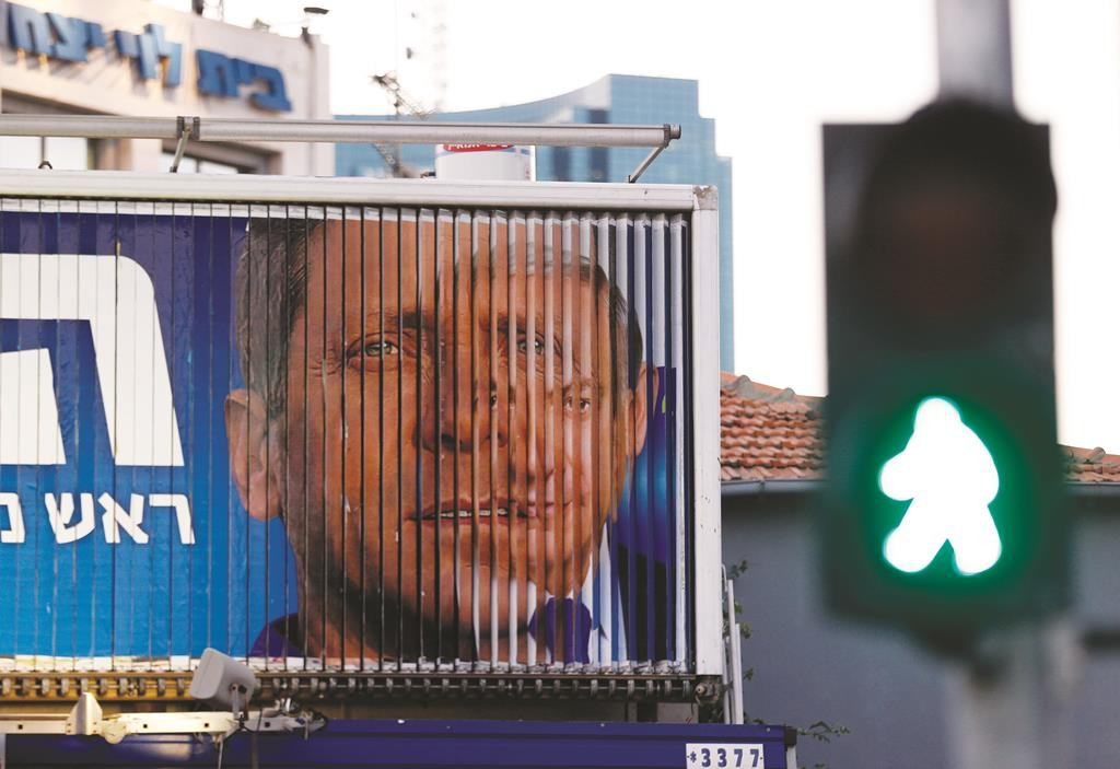 A rotating campaign billboard in Tel Aviv depicts Israel's Prime Minister Binyamin Netanyahu (R) and Isaac Herzog, co-leader of the center-left Zionist Union. (REUTERS/Baz Ratner)