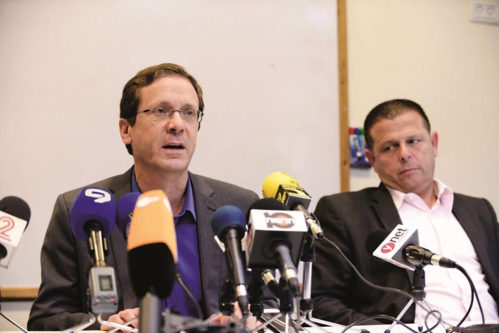 Co-leader of the Zionist Camp party and Labor Party's leader, Isaac Herzog (L) arrives for a press conference after his defeat in the elections.  (JACK GUEZ/AFP/Getty Images)