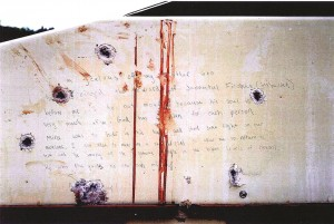 This forensics photograph presented as evidence during the trial of Dzhokhar Tsarnaev, Tuesday, in Boston, shows a handwritten confession on the bullet-riddled, blood-stained wall of a boat.  (AP Photo/U.S. Attorney's Office)