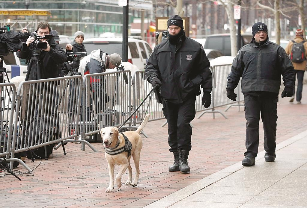Boston police officers patrol outside federal court in Boston, during the federal death-penalty trial of Boston-Marathon bombing suspect Dzhokhar Tsarnaev. (AP Photo/Michael Dwyer)