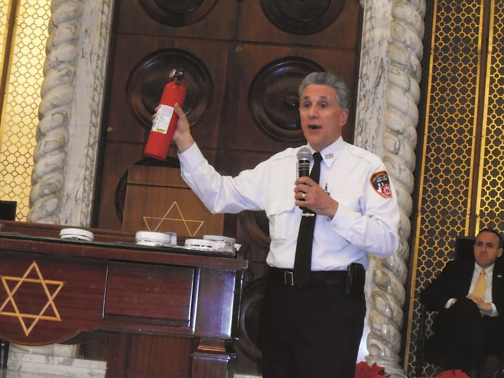 FDNY Lt. Anthony Mancuso displays a fire extinguisher as part of home fire-prevention plans.