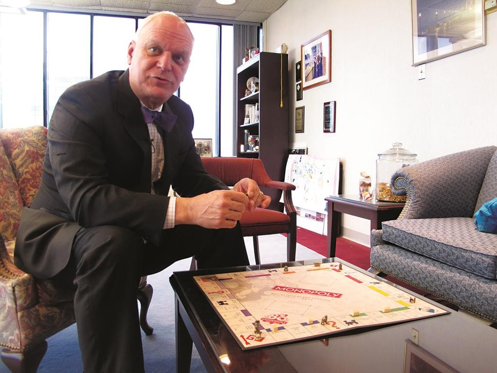 Atlantic City Mayor Don Guardian holds a Monopoly game piece at City Hall last week. (AP Photo/Wayne Parry)