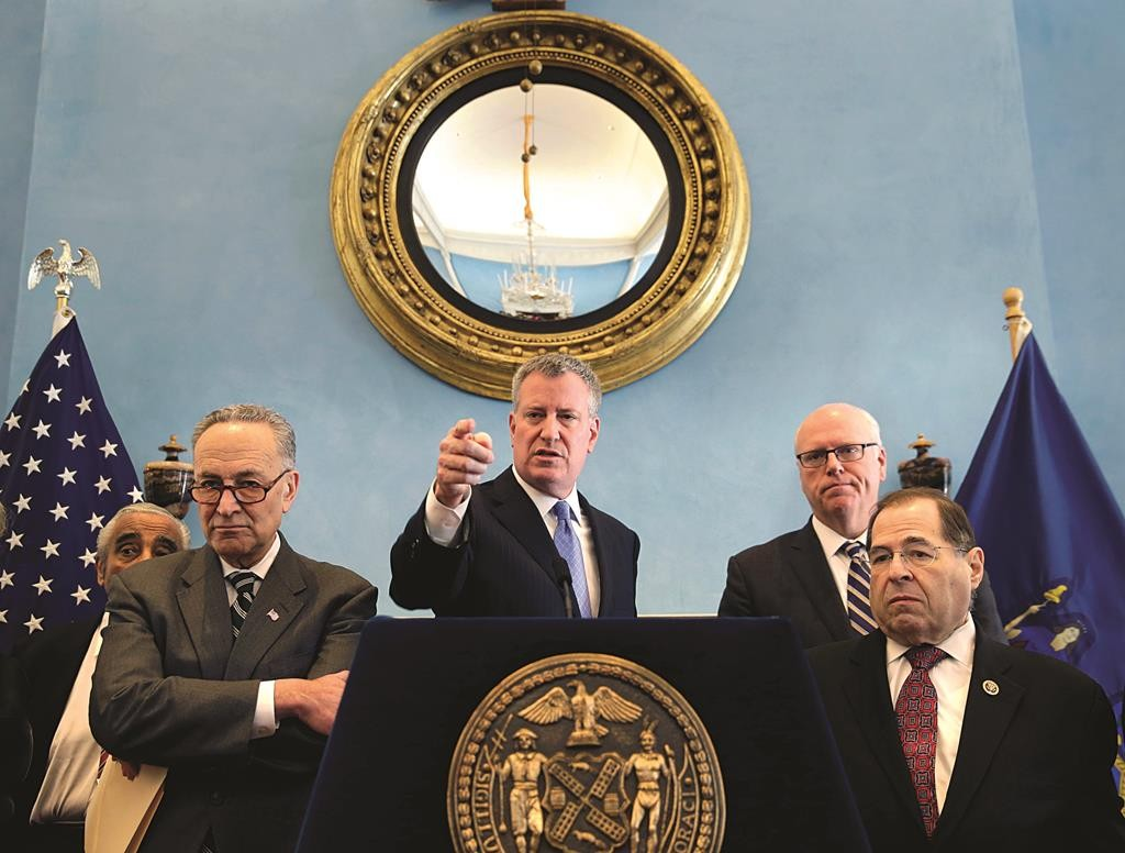 Surrounded by New York state politicians, New York City Mayor Bill de Blasio, center, takes questions from the media during a news conference about Homeland Security funding in New York, Monday, March 2, 2015. (AP Photo/Seth Wenig)