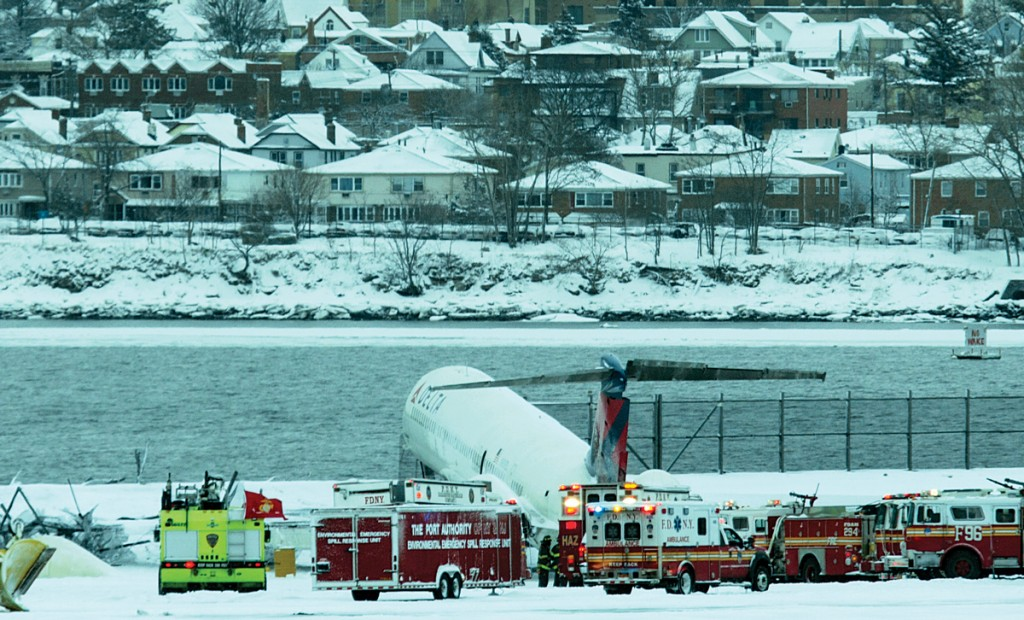 A plane on Thursday rests near the water at LaGuardia as passengers evacuate. (AP Photo/Craig Ruttle - Amber Reid)