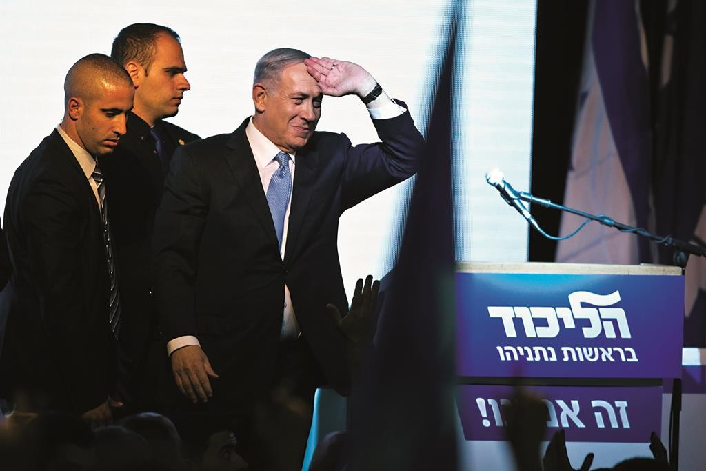 Prime Minister Binyamin Netanyahu gestures as he arrives to deliver a victory speech to supporters at party headquarters in Tel Aviv on Wednesday. (*REUTERS/Nir Elias)