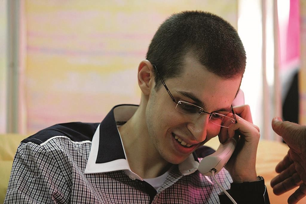 Gilad Shalit on the phone with his parents, shortly after arriving in Israel after over five years in captivity. (Israel Defense Forces)