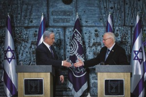 Prime Minister Binyamin Netanyahu (L) meets with Israeli President Reuven Rivlin in a brief ceremony tasking Netanyahu to form the next Israeli government, at the president's residence on Wednesday. (Photo by Miriam Alster/Flash90)