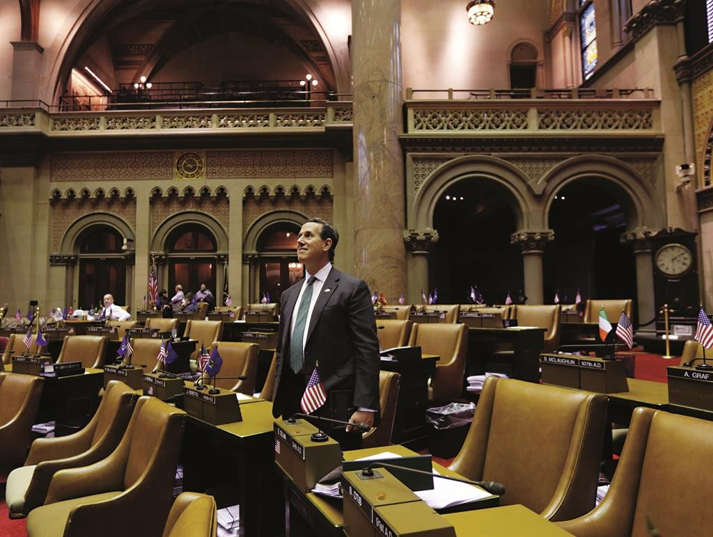 Former Senator Rick Santorum tours the Assembly Chamber in Albany on Tuesday. (AP Photo/Mike Groll)