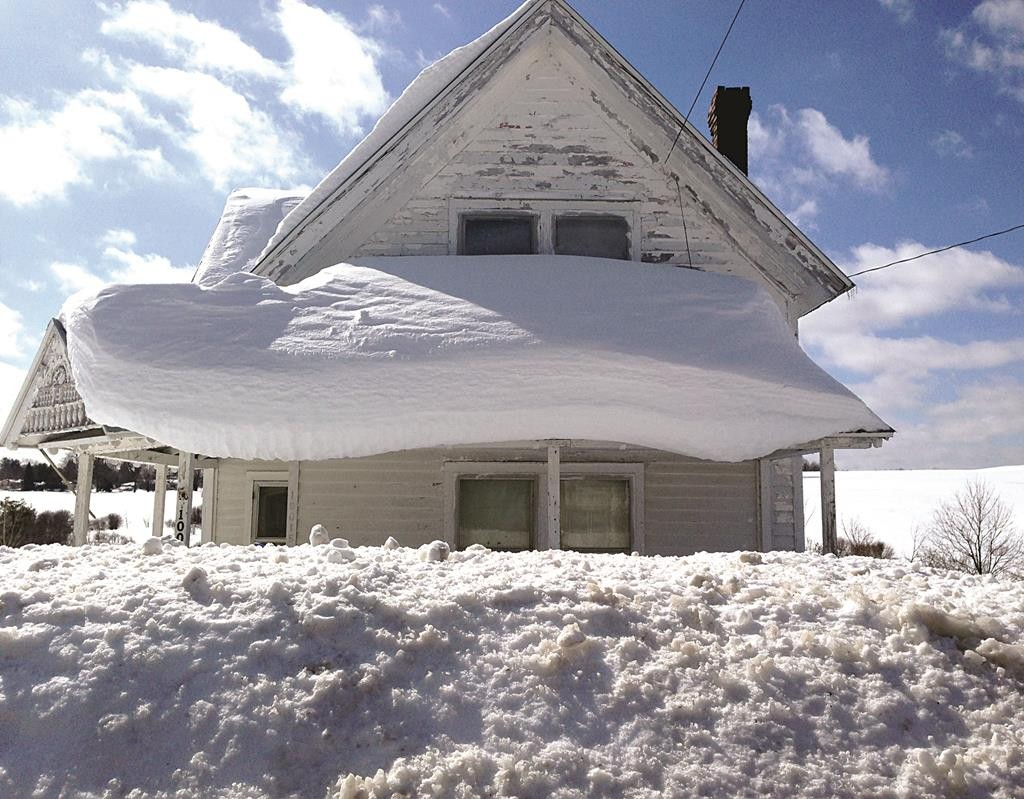 Heavy snow on Friday covers the village of Copenhagen, N.Y., the snowiest place in America. (AP Photo/The Syracuse Newspapers, Glenn Coin)