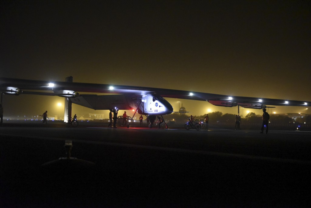"In this photo released by Solar Impulse, ""Solar Impulse 2,"" a solar-powered airplane piloted by Bertrand Piccard, lands in Ahmedabad, India, on Tuesday, March 10, 2015, during its historic round-the-world journey. The trip continues this weekend with Piccard's partner and Solar Impulse co-founder, André Borschberg, as pilot. (AP Photo/Solar Impulse, Jean Revillard)"