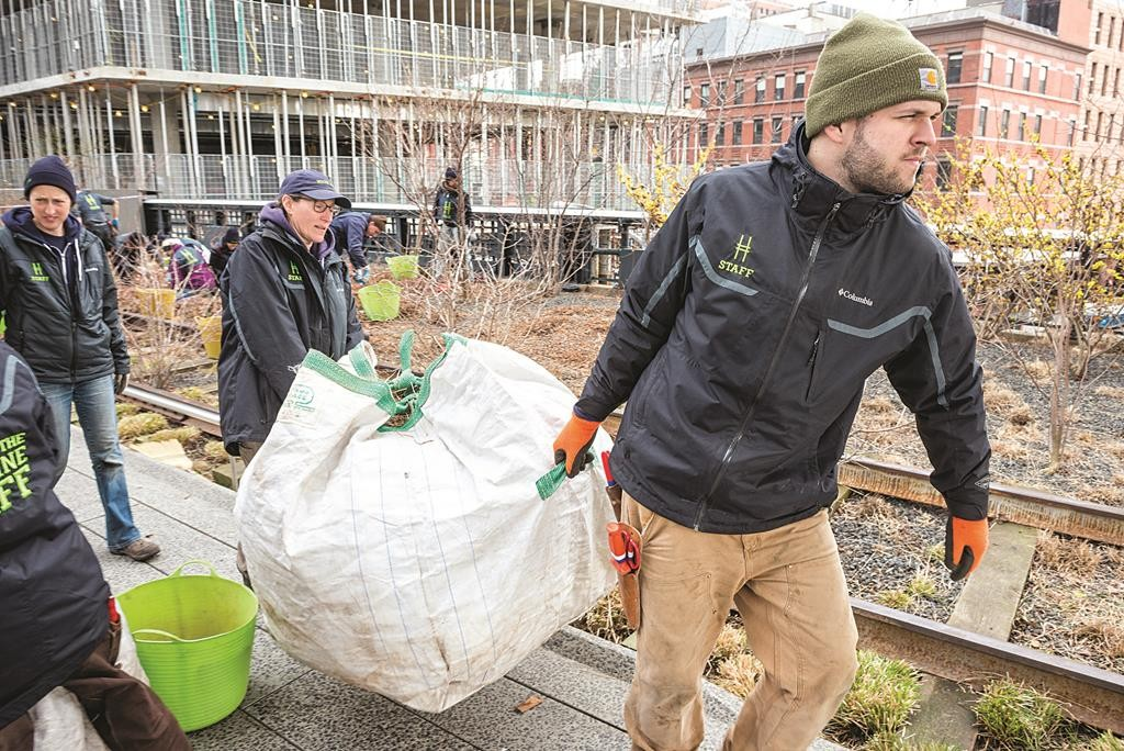 Spring on the High Line: Volunteers collect garbage on Monday at Manhattan elevated park in preparation for Friday's arrival of spring.