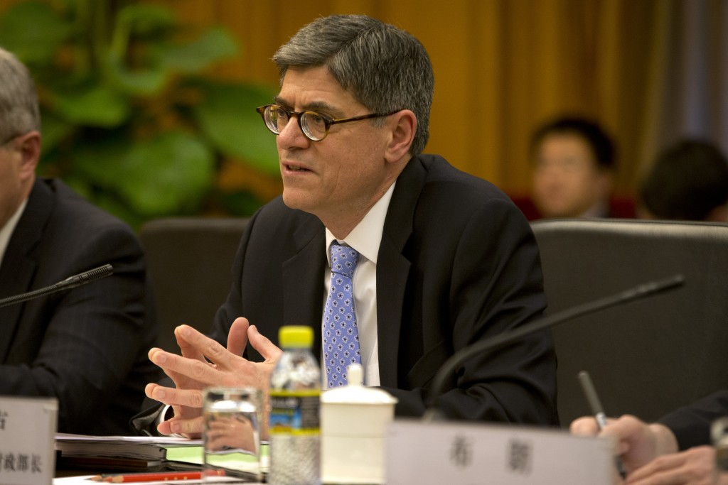 "U.S. Treasury Secretary Jacob Lew speaks at the start of a meeting with Chinese Vice Premier Wang Yang at the Zhongnanhai Leadership Compound in Beijing on Monday, March 30, 2015. In the meeting, Lew expressed ""deep concern"" about the curbs in proposed bank security and anti-terrorism rules. (AP Photo/Mark Schiefelbein, Pool)"