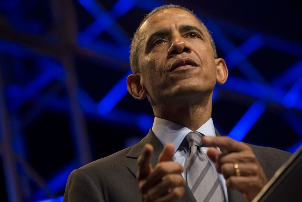 President Barack Obama speaks at the National League of Cities' annual Congressional City Conference in Washington on Monday, March 9, 2015.  (AP Photo/Jacquelyn Martin)