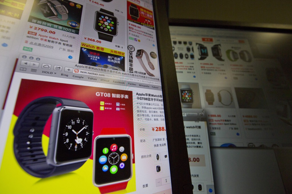 """An e-commerce website with a vendor selling the """"Apple Smart Watch Bluetooth Bracelet"""" starting from 288 yuan (US$45) is displayed on a computer screen in Beijing on Thursday, March 12, 2015. A month before Apple Inc.'s smartwatch hits the market, China's thriving copycat manufacturers are selling look-alikes, some openly advertised as Apple copies. (AP Photo/Ng Han Guan)"""