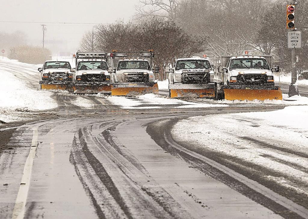 A team of snow plows on Thursday in North Cape May, N.J. (AP Photo/The Press of Atlantic City, Dale Gerhard)