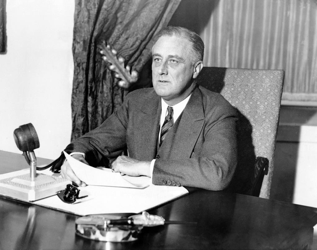 President Franklin D. Roosevelt speaking to the people via radio, on March 12, 1933.  (AP Photo)