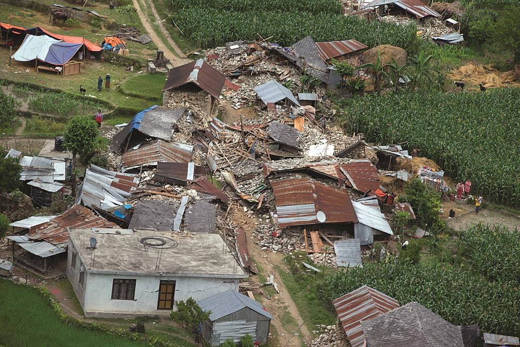 Houses on the higher reaches of mountains destroyed in Saturday's earthquake seen from a helicopter near Dhadingbesti, in Nepal, Wednesday.  (AP Photo/Manish Swarup)