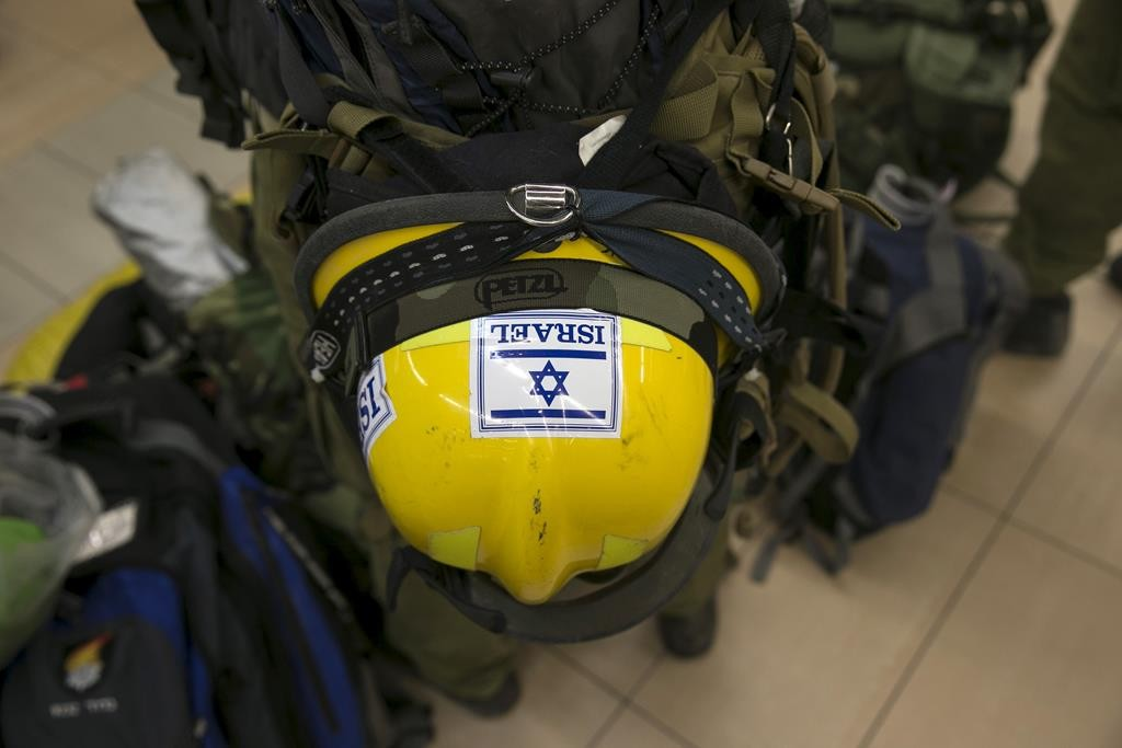 The helmet of an Israeli soldier and member of an aid delegation is seen as he waits for a flight to Nepal at Ben Gurion international airport near Tel Aviv, Israel, on Sunday. (REUTERS/Baz Ratner)