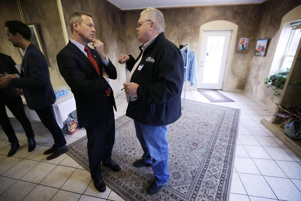 Former Maryland Gov. Martin O'Malley talks with Earl Agan, of Des Moines, Iowa, right, during a recent fundraiser. (AP Photo/Charlie Neibergall)