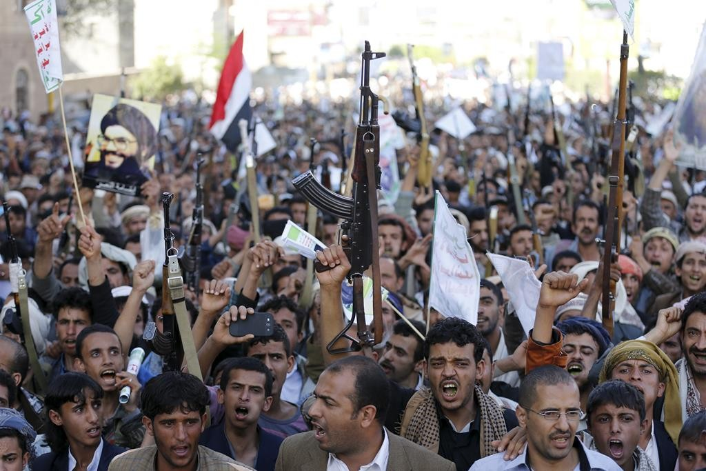 Followers of the Houthi group demonstrate against the Saudi-led air strikes in Sanaa, Wednesday. (REUTERS/Khaled Abdullah)