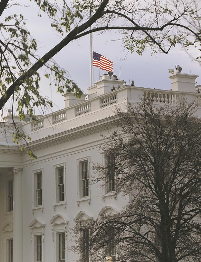 The American flag flies at half-staff at the White House in Washington Wednesday. The 16th president of the United States, Abraham Lincoln, died 150 years ago, the result of being assassinated at Ford's Theatre on the evening of April 14, 1865, by actor John Wilkes Booth.  (REUTERS/Gary Cameron)