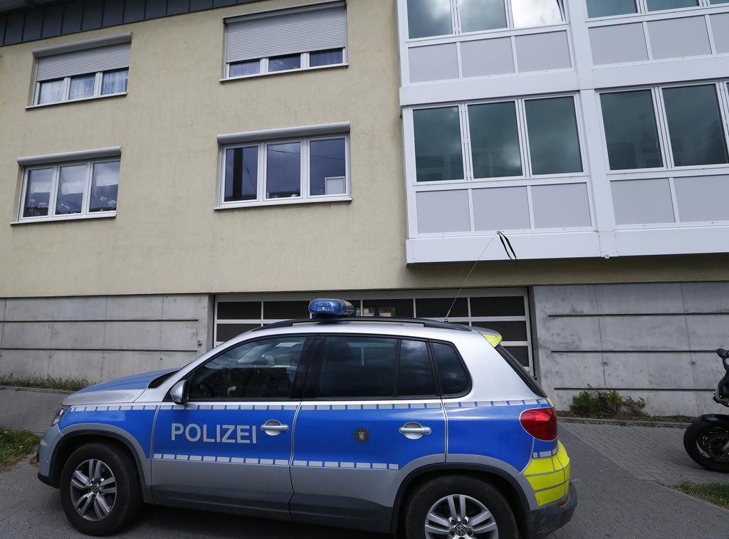 A police car stands in front of a building where suspected Islamist terrorists are beleived to live, in Oberursel near Frankfurt, Germany Thursday.  (REUTERS/Ralph Orlowski)