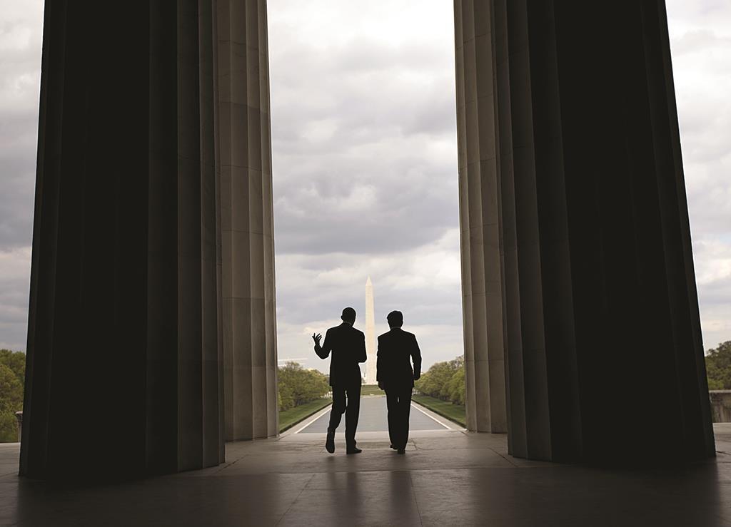 President Barack Obama (L) and Japanese Prime Minister Shinzo Abe visit the Lincoln Memorial, looking toward the Washington Monument, on the National Mall in Washington, Monday. (AP Photo/Pablo Martinez Monsivais)