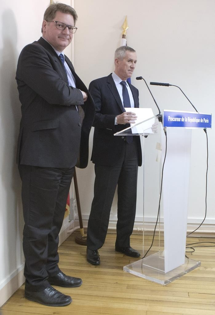 Paris Prosecutor Francois Molins (R) with Christian Saintes, head of French criminal police, at the meeting for the media in Paris, France, Wednesday. (AP Jacques Brinon)