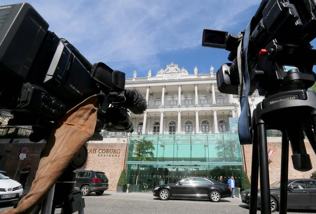Cameras stand in front of a luxury downtown hotel, where closed-door nuclear talks with Iran take place, in Vienna, Austria, Wednesday. (AP Photo/Ronald Zak)