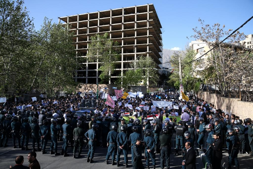 Protesters chant slogans during a demonstration against the Saudi-led coalition strikes on Yemen, in front of the Saudi Embassy in Tehran, Iran, Monday. (AP Photo/Ebrahim Noroozi)