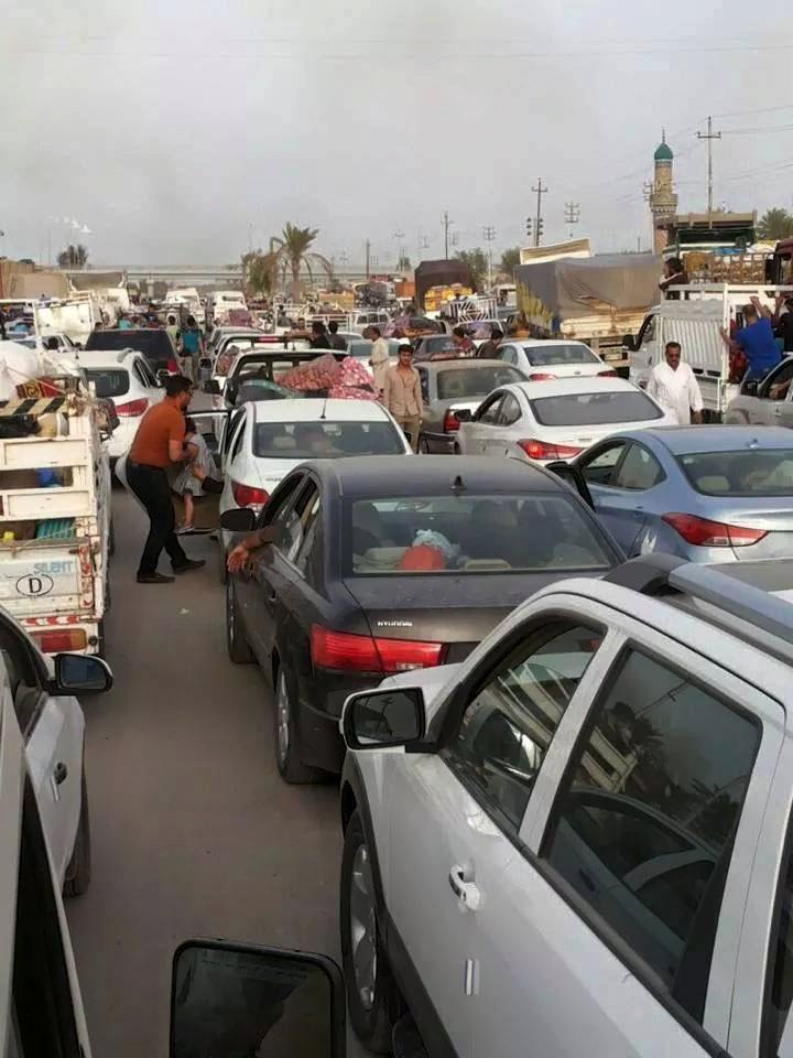 People leave their hometown Ramadi, Thursday. (AP Photo)