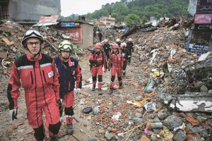French rescue workers walk among earthquake debris as they look for survivors in the Nepalese capital Kathmandu on April 28, 2015. (NICOLAS ASFOURI/AFP/Getty Images)
