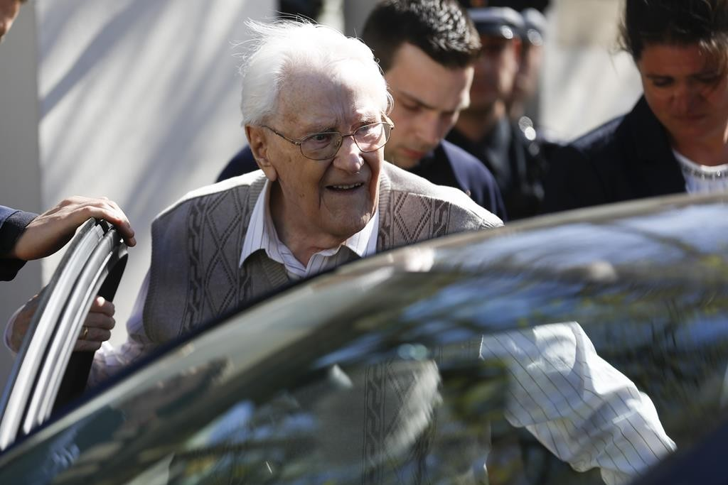 Former SS guard Oskar Groening enters a car after the first day of the trial against him in Lueneburg, northern Germany, Tuesday. (AP Photo/Markus Schreiber)