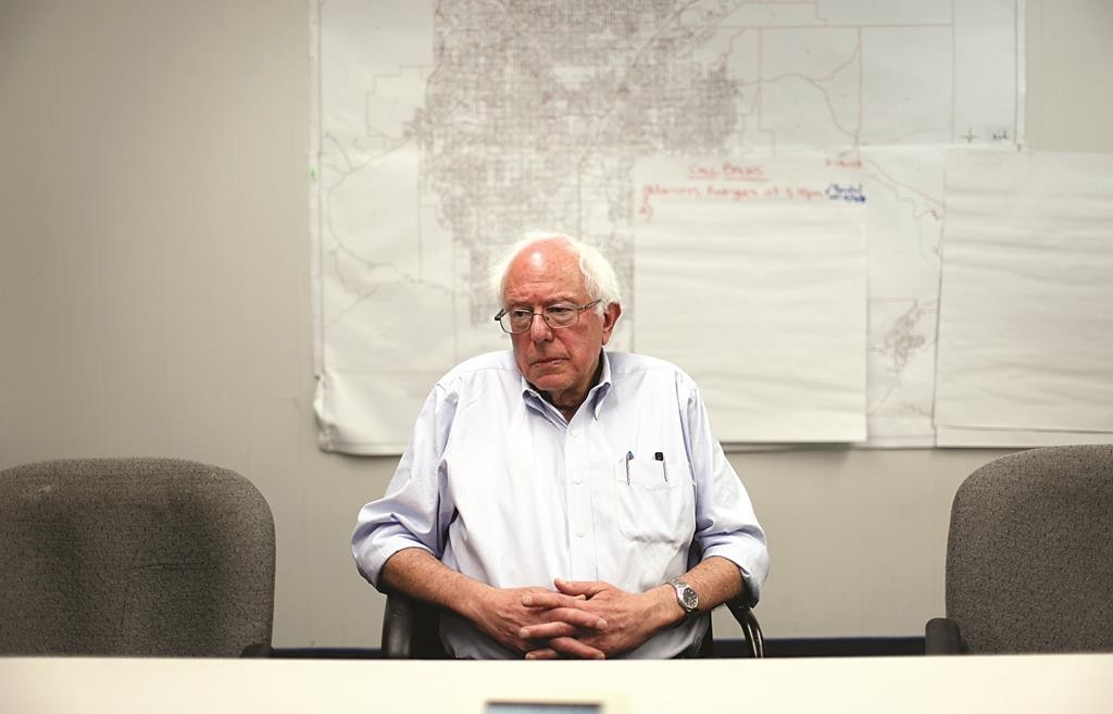 Sen. Bernie Sanders, I-Vt., speaks with reporters after a recent town hall meeting in Las Vegas. (AP Photo/John Locher)