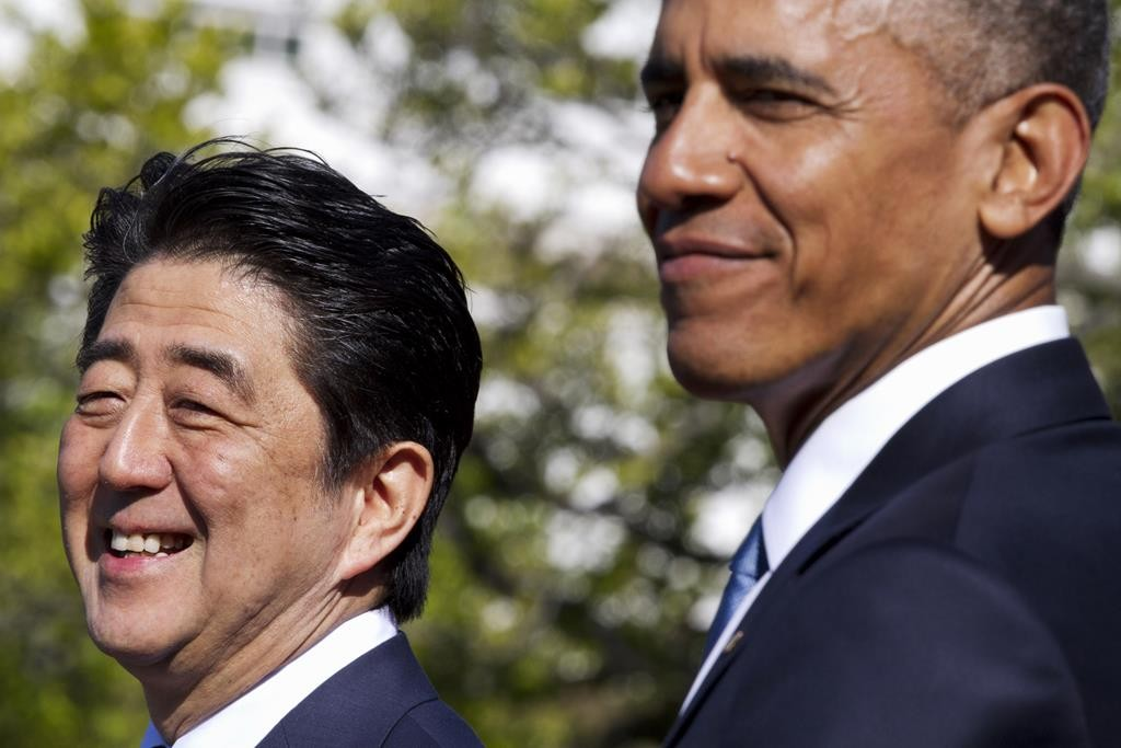 President Barack Obama hosts a state arrival ceremony for Japanese Prime Minister Shinzo Abe, Tuesday, on the South Lawn of the White House in Washington.  (AP Photo/Jacquelyn Martin)