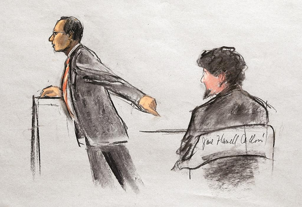 In this courtroom sketch, Assistant U.S. Attorney Aloke Chakravarty is depicted pointing to defendant Dzhokhar Tsarnaev, right, during closing arguments in Tsarnaev's federal death penalty trial. (AP Photo/Jane Flavell Collins)