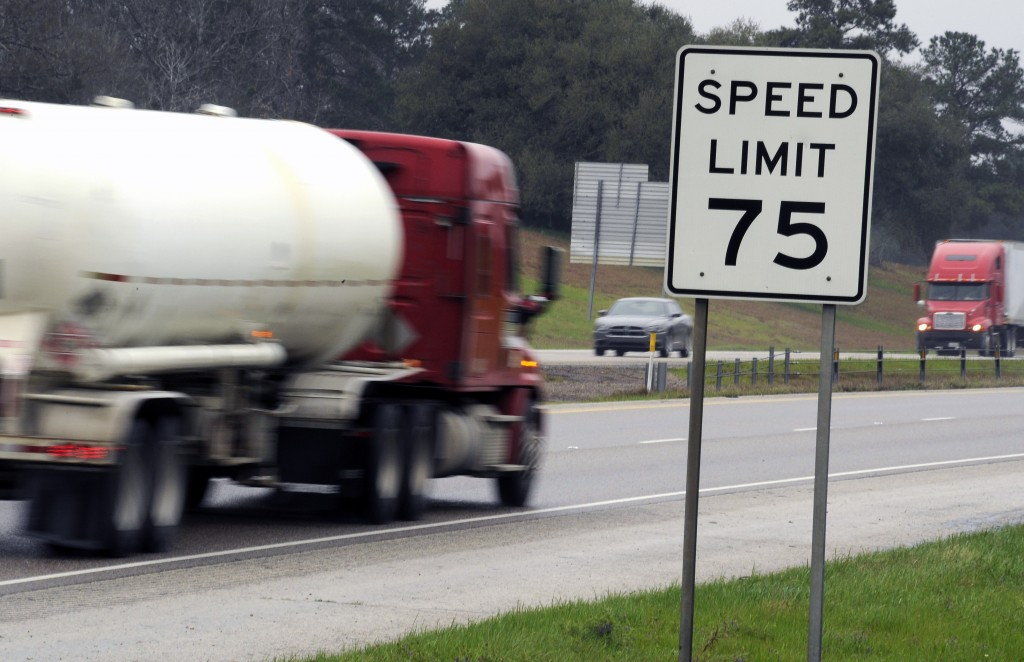 Trucks travel along I-45 near Huntsville, Texas, on Thursday, March 12, 2015. Most tractor-trailers and big buses on U.S. highways ride on tires that weren't designed to handle speeds above 75 miles per hour. (AP Photo/Pat Sullivan)
