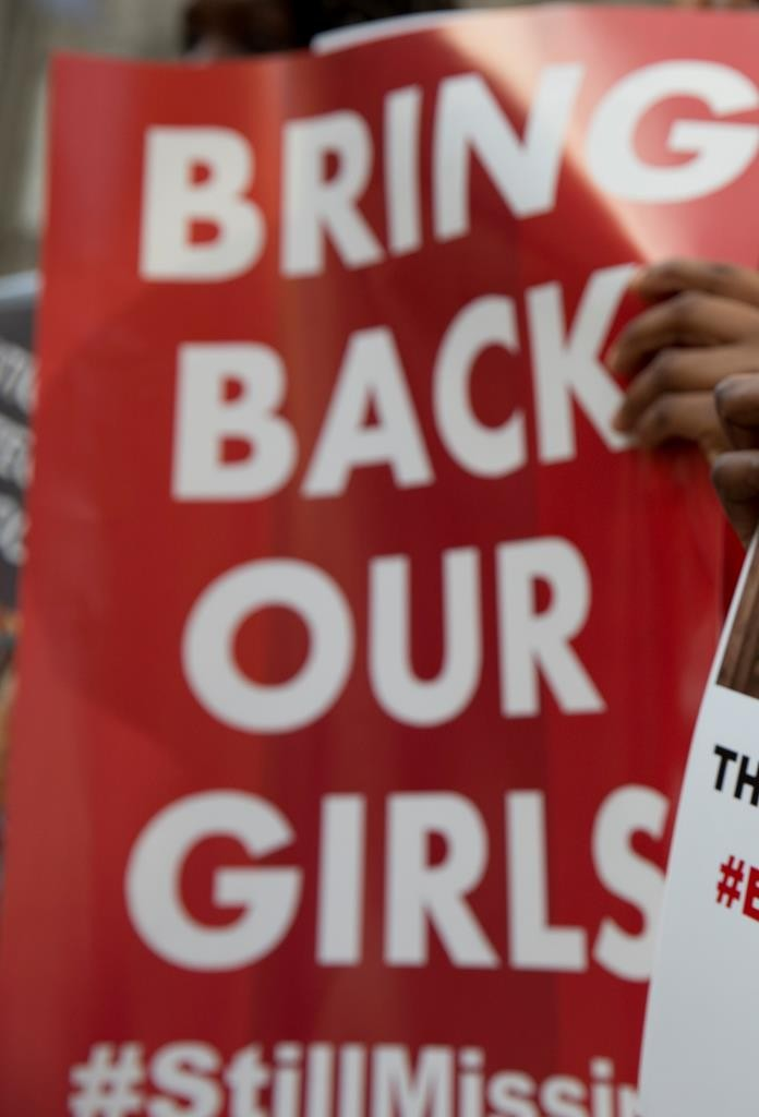 Protesters holds up placards demanding help from the Nigerian government to find the 219 girls who remain missing on the first anniversary of the kidnapping by Islamic extremists, during a demonstration outside the Nigerian High Commission in London, Tuesday. (AP Photo/Alastair Grant)
