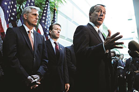 Rep. Peter Roskam (R-IL) (2nd L) and Majority Leader Rep. Kevin McCarthy (R-CA) (L), listen as U.S. Speaker of the House Rep. John Boehner (R-OH) (R) speaks to the media.  (Alex Wong/Getty Images)