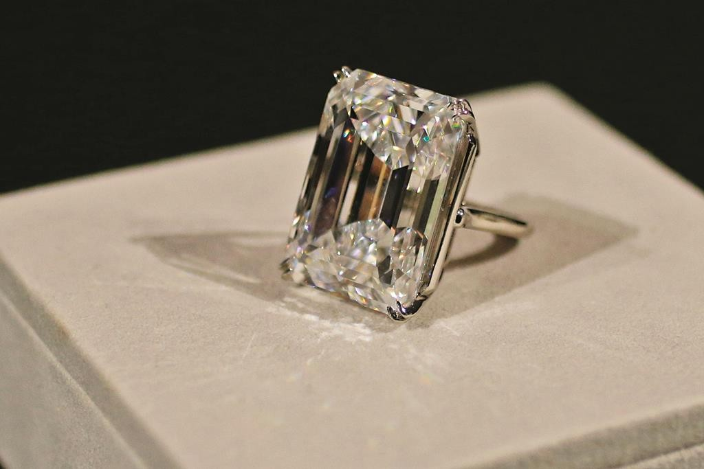 """A """"perfect"""" 100-karat emerald-cut diamond is on display Friday at Sotheby's in New York. (AP Photo/Mary Altaffer)"""