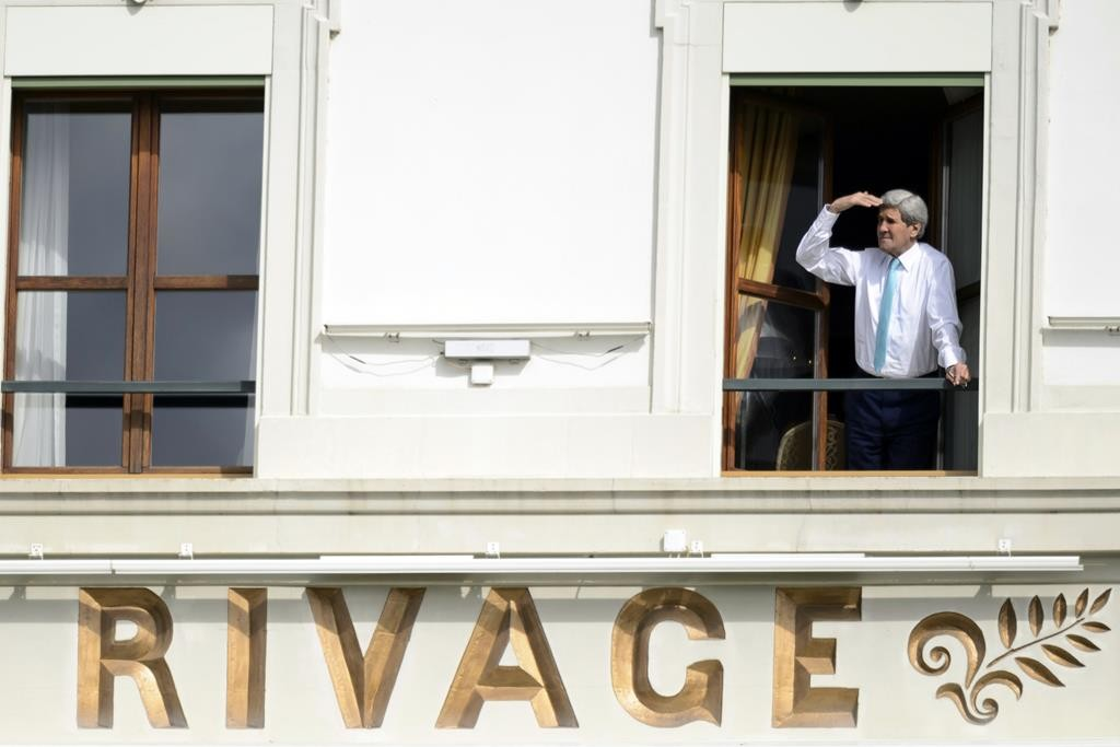 Secretary of State John Kerry looks at the view of Lake Geneva from his hotel room as the Iran nuclear talks continue in Lausanne, Switzerland, Wednesday. (AP Photo/Keystone, Laurent Gillieron)