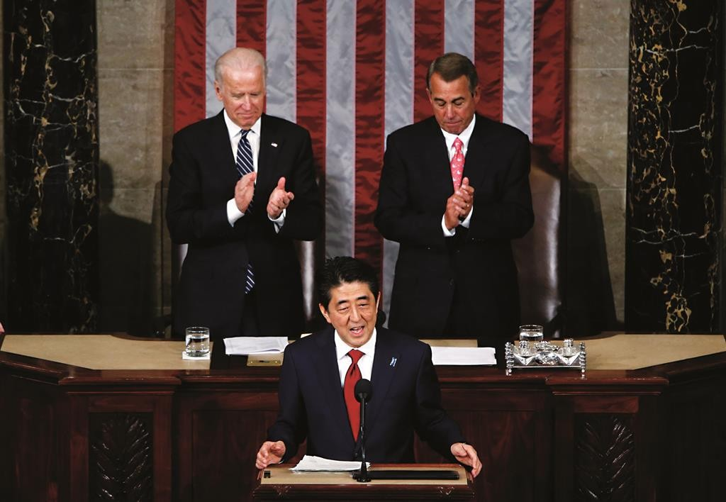 Japanese Prime Minister Shinzo Abe (C) addresses a joint meeting of Congress in front of Vice President Joe Biden (L) and House Speaker John Boehner (R-OH), on Capitol Hill in Washington, Wednesday. (REUTERS/Jonathan Ernst)